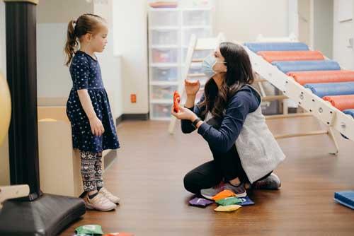 Speech therapist working with child patient